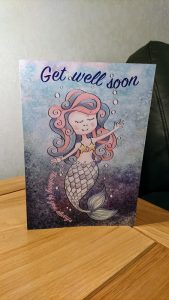Get well soon card on table top