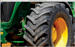 Digital painting of a tractor in a field wheel detail
